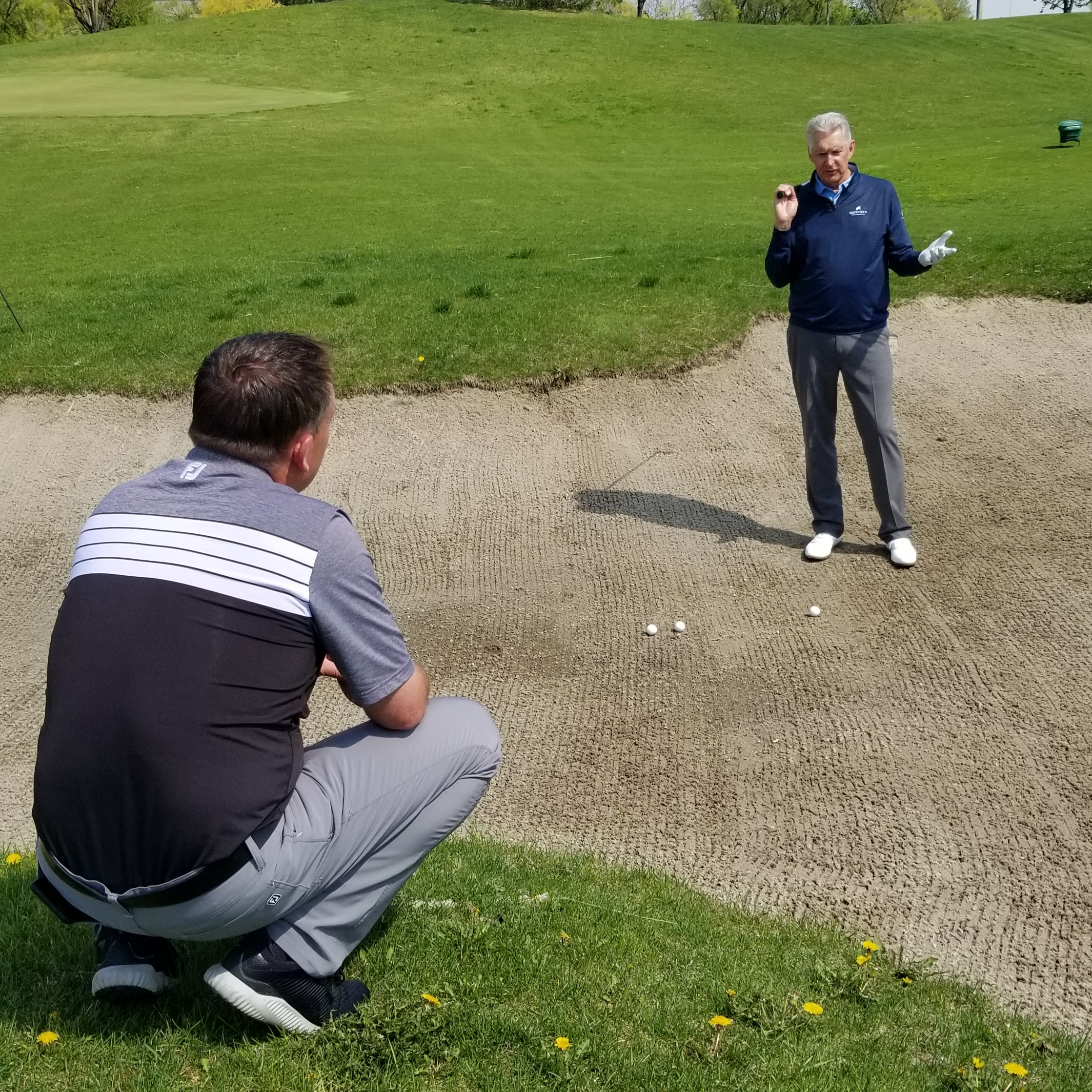 Todd Kolb and Andy North discussing bunker shots