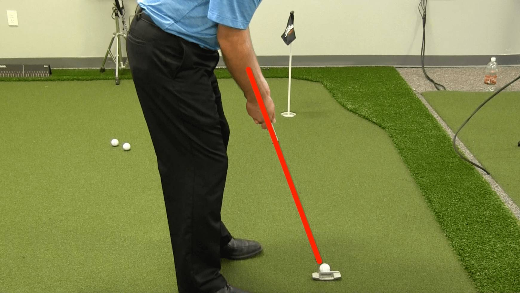 Having the putter in line with the forearms can really improve your putting setup