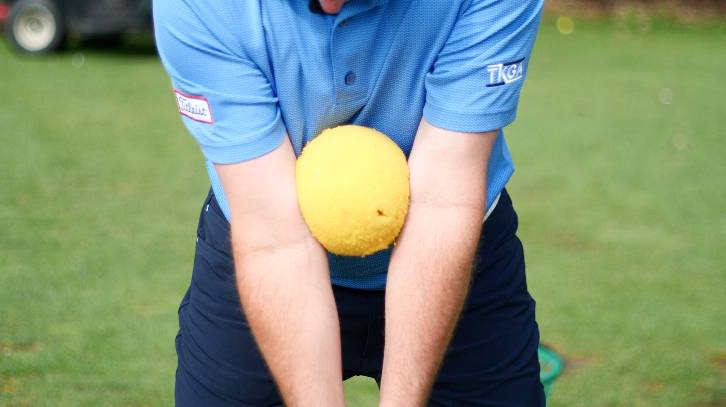 A simple ball can help you work on your golf backswing