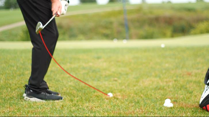 Dragging the club inside and around the body often causes golfers to hit behind or top chip shots