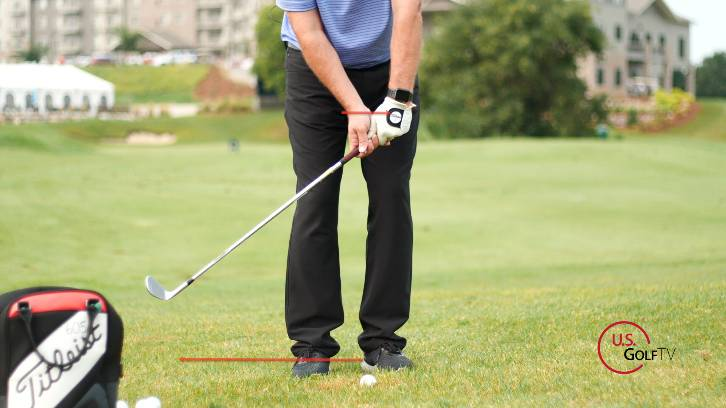Hinging the wrists causes golfers to speed up the club and stab at the ball, resulting in poor contact