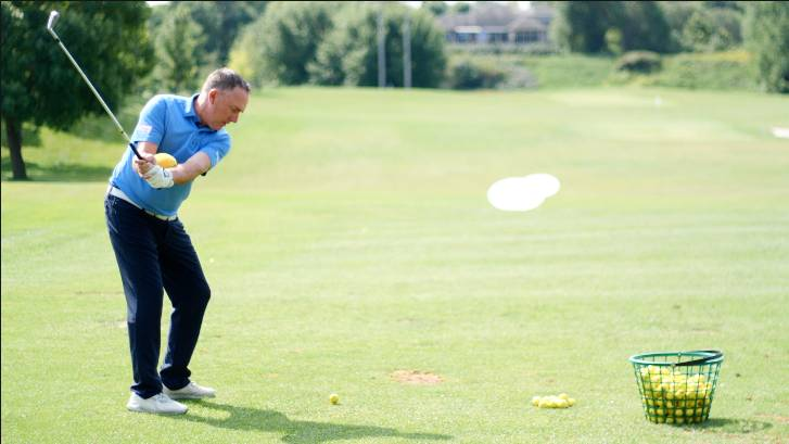 Using a small ball between the arms can help you work on these common golf backswing mistakes